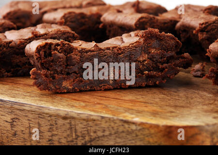 Brownie stack, chocolate cake on rustic wooden board on table - Stock Photo