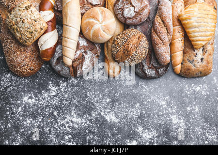 Variety of delicious freshly baked and healthy bread - Stock Photo