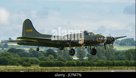 B-17 Flying Fortress in flight at 2016 Yeovilton Airshow. - Stock Photo