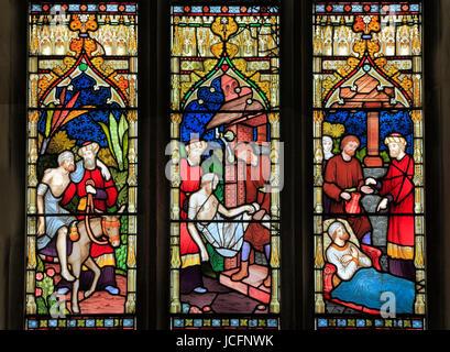 Parable of The Good Samaritan, stained glass by Frederick Preedy, 1865, Gunthorpe, Norfolk, England, UK, Good Samaritan - Stock Photo
