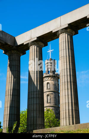 The Nelson Monument and National Monument on Calton Hill in Edinburgh, Scotland, United Kingdom - Stock Photo