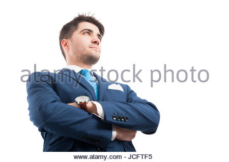 Low angle of confident lawyer or salesman in super hero shot on white background - Stock Photo