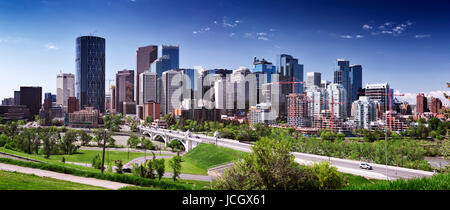 Calgary city downtown beautiful skyline panoramic view with Centre Street Bridge over Bow river, summer day urban - Stock Photo