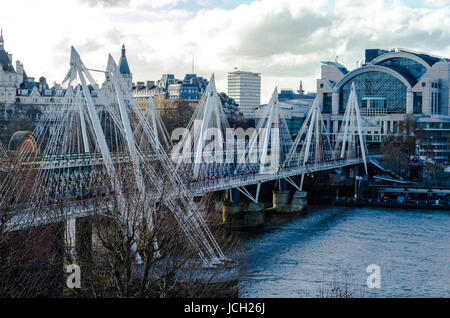 Hungerford and Golden Jubilee Bridges on the River Thames, London - Stock Photo