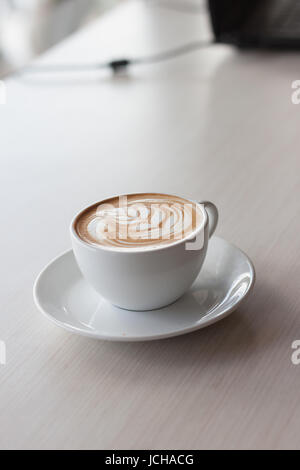 Cup of hot coffee latte on wood table.Leisure time. Relaxation in Thailand - Stock Photo