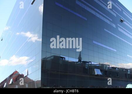 View of the modern building called the black diamond situated in the danish capital city of Copenhagen - Stock Photo