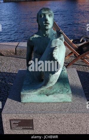 Mermaid statue in front of the main harbour The Black Diamond, The Copenhagen Royal Library (Det Kongelige Bibliotek) - Stock Photo