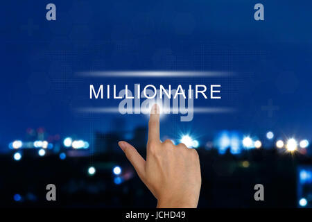 hand clicking millionaire button on a touch screen interface - Stock Photo