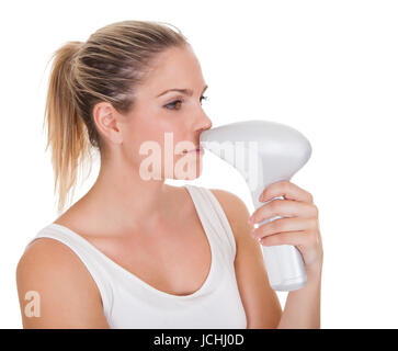 Happy Young Woman Doing Laser Therapy On White Background - Stock Photo
