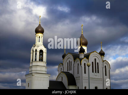 Beautiful scenic view - Russian Orthodox Church of St. Joseph Volotskiy at the background of dramatic stormy sky - Stock Photo