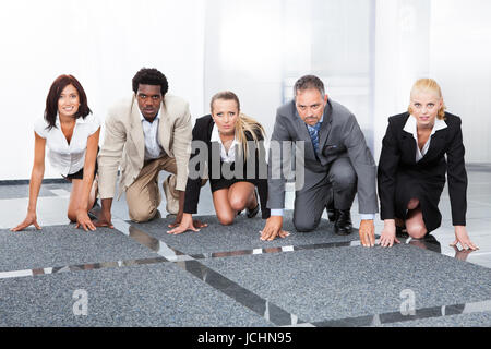 Multiracial Businesspeople In A Row Being Ready For Competition - Stock Photo