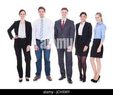 Group Of Happy Business People Standing In Pose Over White Background - Stock Photo