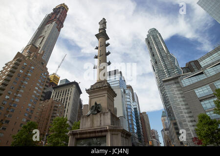 statue of christopher columbus in columbus circle with expensive luxury south central park apartment buildings New - Stock Photo