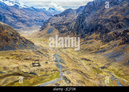Looking down on Incan Ruins in a valley as seen from high up in the Andes mountains of the Cordillera Real near - Stock Photo