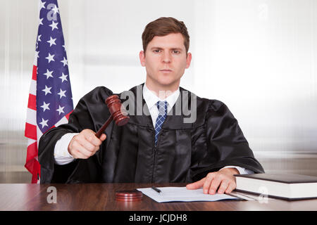 Male Judge With The Gavel And Book In Courtroom - Stock Photo