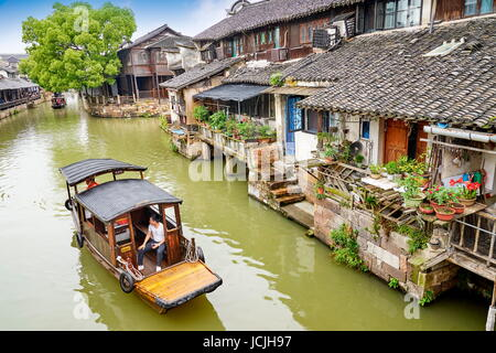 Traditional wooden chinese boat on the Wuzhen canal, Zhejiang province, China - Stock Photo