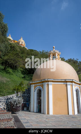 Church of Our Lady of Remedies at the top of Cholula pyramid and Well of Wishes - Cholula, Puebla, Mexico - Stock Photo