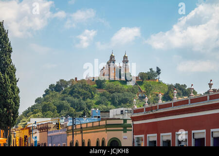 Street of Cholula and Church of Our Lady of Remedies at the top of Cholula pyramid - Cholula, Puebla, Mexico - Stock Photo