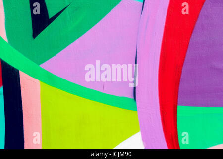 Bright wall with detail of a graffiti, street art. Abstract creative drawing fashion colors. Modern iconic urban - Stock Photo