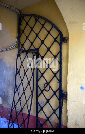 A rickety old iron gate leads through an arch to the Patkuli Vaateplats viewpoint from Rahukohtu, Toompea (Cathedral - Stock Photo