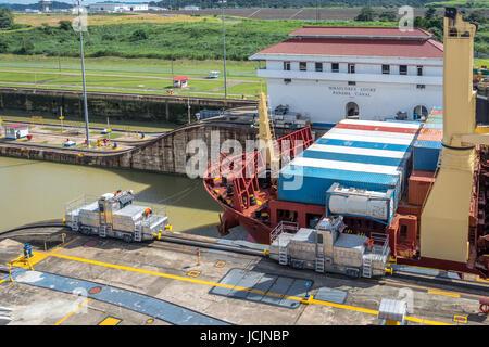 Cargo Ship crossing Panama Canal at Miraflores Locks - Panama City, Panama - Stock Photo