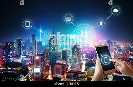 Unknown woman using smartphone with cityscape and network mobile payments, online shopping concept background . - Stock Photo