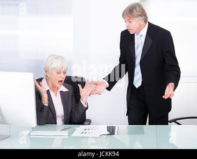 Portrait Of Businessman Arguing With Businesswoman At Work - Stock Photo