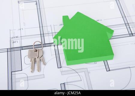Closeup of green house and keys on blueprint - Stock Photo