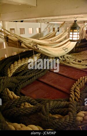 HMS Victory Nelson's flagship preserved at the Portsmouth Historic Dockyard Hampshire UK Sailor's hammocks slung - Stock Photo