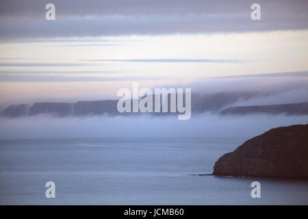 Mist falling from  cliffs South of Scarborough North Yorkshire UK - Stock Photo