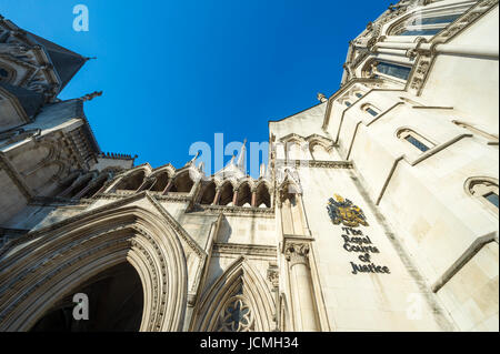 The Victorian Gothic style main entrance to the The Royal Courts of Justice public building in London, UK, opened - Stock Photo