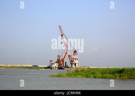 Bridge construction work in progress on the Padma River. Bangladesh - Stock Photo