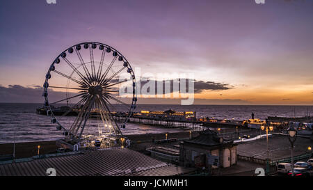 The Victorian Brighton Pier, also known as the Palace Pier and the Brighton wheel after sunset - Stock Photo