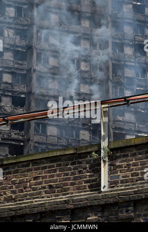 View of smouldering remnants of Grenfell Tower in West London,UK - Stock Photo