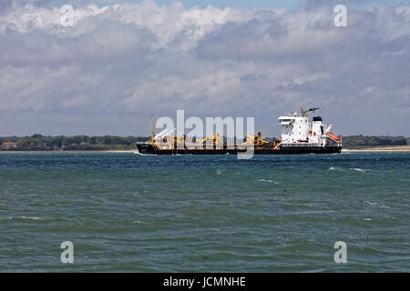 The Sand Heron a 'suction hopper dredger' owned by Cemex Aggregates Marine Ltd makes her way across Southampton - Stock Photo