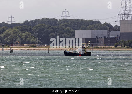 fishing vessel P6 Solent Star working in Southampton water with Fawley power station in background