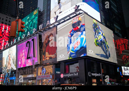 huge electronic displays on 1540 broadway evening in Times Square New York City USA - Stock Photo