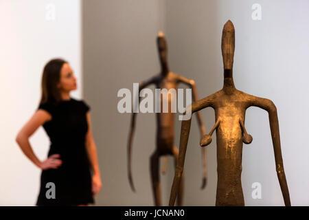 London, UK. 16 June 2017. A Christie's employee looks at the Antony Gromley sculptures Inside Australia Prototype - Stock Photo