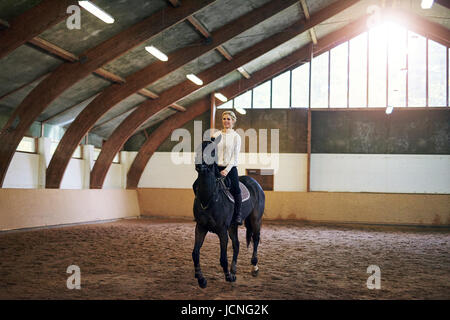 Cowgirl On A Black Horse Riding By Stock Photo 39405978