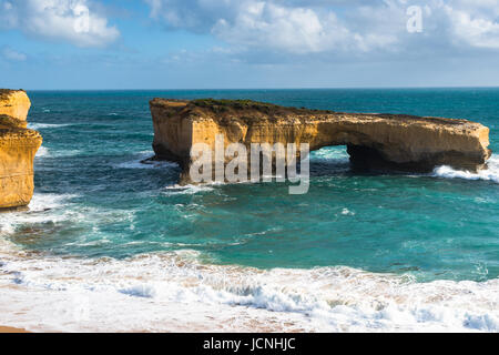London Bridge, a famous rock arch in the Port Campbell National Park at the Great Ocean Road in Victoria, Australia. - Stock Photo