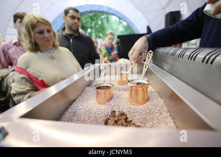 Moscow, Russia. 16th June, 2017. Preparing Turkish coffee on hot sand at the 1st Turkey Festival in Moscow's Krasnaya - Stock Photo