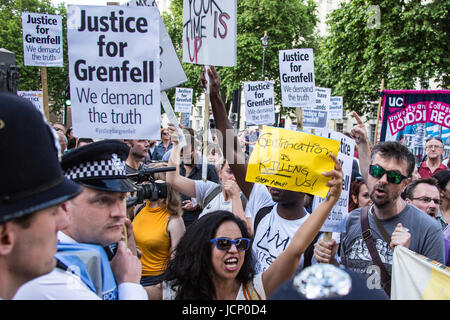 London, UK. 16th June, 2017. Thousands of demonstrators, including friends and family of victims of the Grenfell - Stock Photo