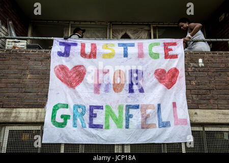 London, UK. 16th June, 2017. 'Justice For Grenfell' banner is hung from neighbouring Lancaster West housing estate. - Stock Photo