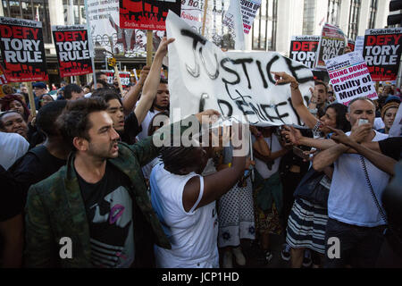 London, UK. 16th June, 2017. Members of the community of North Kensington take part in a protest march to demand - Stock Photo