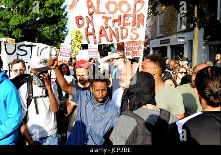 London, UK. 16th June, 2017. Protesters march up during a rally calling for justice for those affected by the Grenfell - Stock Photo