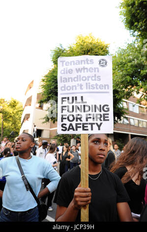 London, UK. 16th June, 2017. A protestor near Grenfell Tower after the arrival of a march through the streets of - Stock Photo