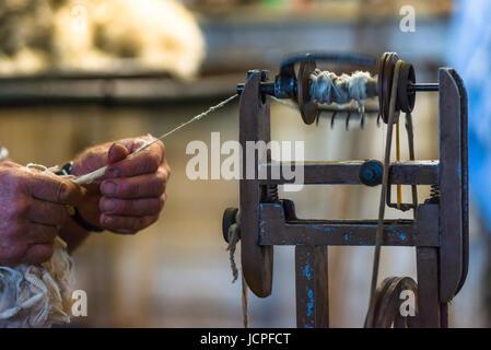 Old wool spinning machine used after shearing a sheep on Kangaroo Island. Australia. - Stock Photo