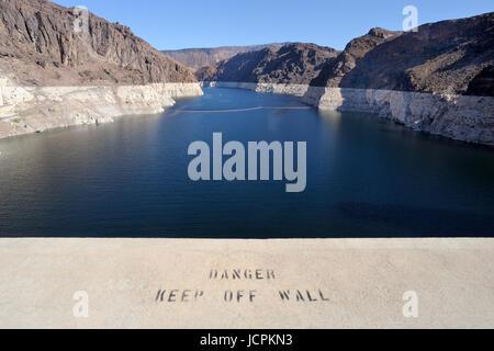 Warning notice  on parapet at Lake Mead from the Hoover Dam Arizona/Nevada border USA - Stock Photo
