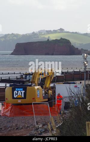 Bulldozer Working on Sea Defences, Dawlish Warren. Devon, UK. June, 2017. - Stock Photo