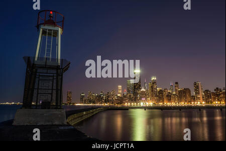 CHICAGO, ILLINOIS, USA - MAY 30, 2016 : Chicago skyline across Lake Michigan at night viewed from North Avenue Beach - Stock Photo